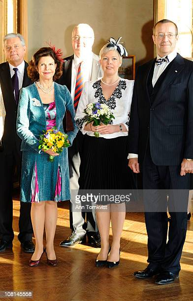 Queen Silvia of Sweden Estonian first lady Evelin Ilves and President Toomas Hendrik Ilves attend a luncheon at City Hall on January 19 2011 in...