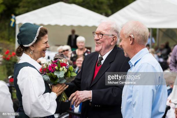 Queen Silvia of Sweden greets 92 year old Villy Johansson a pensioners day at Ekebyhovs Castle on August 23 2017 in Stockholm Sweden