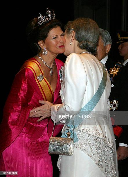 Queen Silvia of Sweden is greeted by Empress Michiko of Japan on arriving for dinner at the Imperial Palace on March 26 2007 in Tokyo Japan The...