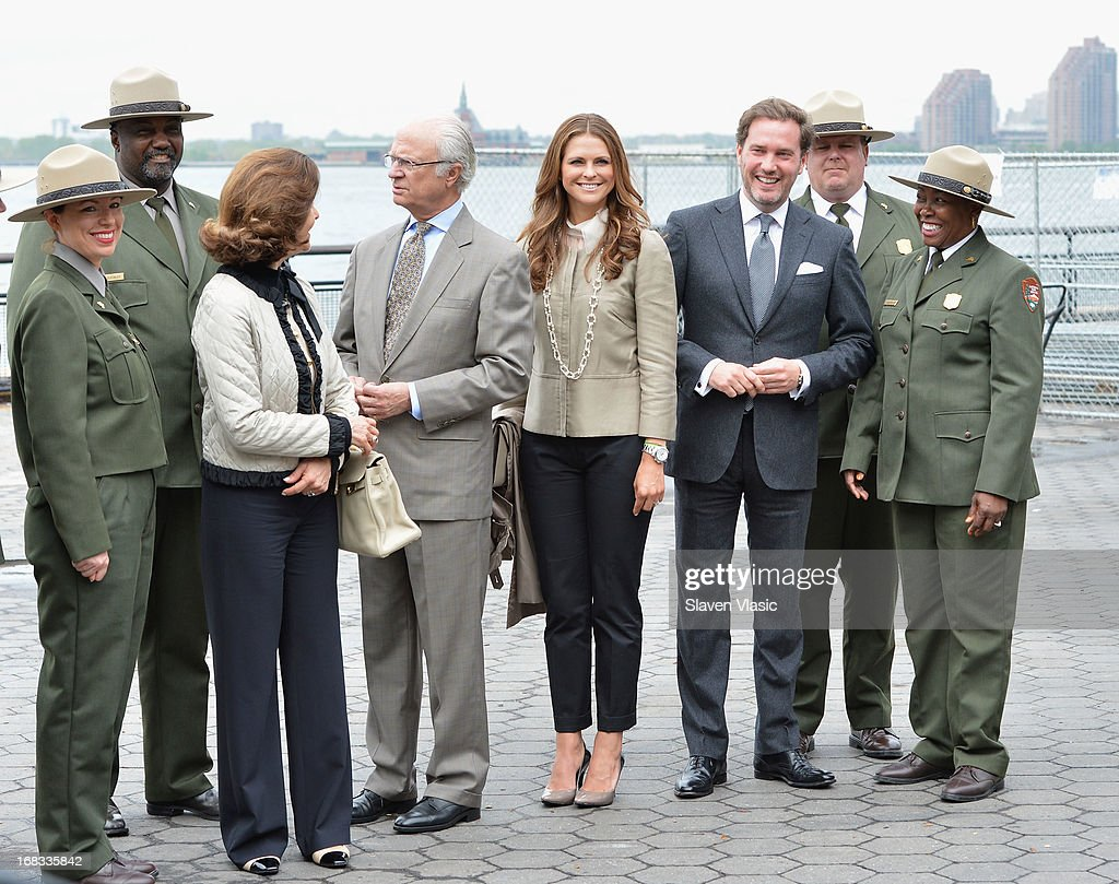 Queen Silvia of Sweden, King Carl XVI Gustaf of Sweden, Princess Madeleine of Sweden and Princess Madeleine's fiance Chris O'Neill visit The Castle Clinton National Monument at Battery Park on May 8, 2013 in New York City.