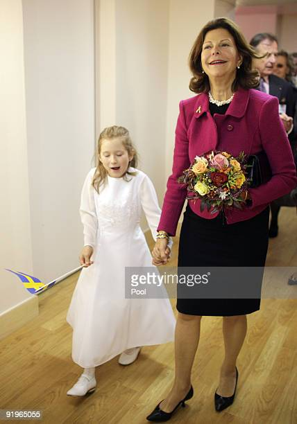 Queen Silvia of Sweden opens together with the sixyearold Julia the first german section in a hospital for dementia patients following the model of...