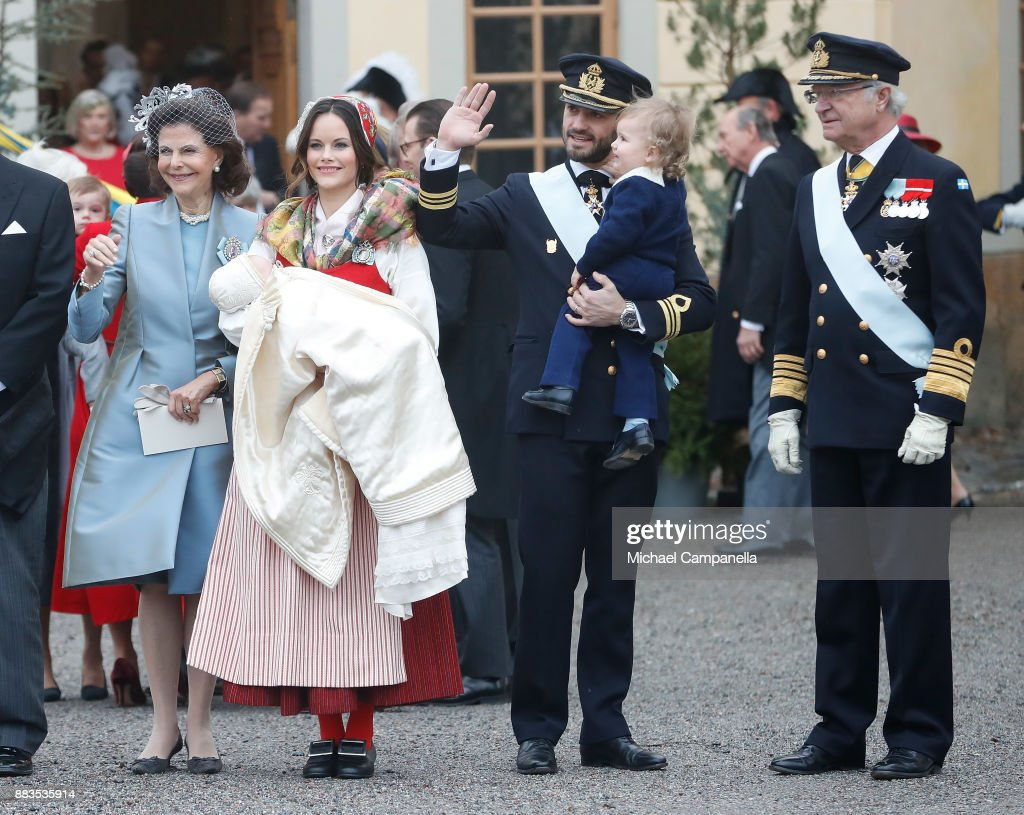 Queen Silvia of Sweden, Prince Gabriel of Sweden, Duke of Dalarna held by Princess Sofia of Sweden and Prince Carl Philip holding Prince Alexander, Duke of Sodermanland and King Carl XVI Gustaf of Sweden attend the christening of Prince Gabriel of Sweden at Drottningholm Palace Chapel on December 1, 2017 in Stockholm, Sweden.