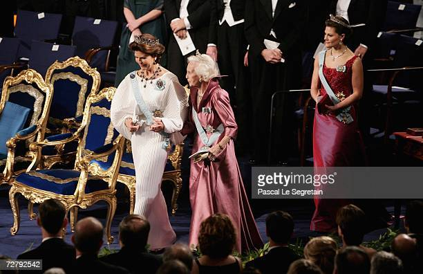 Queen Silvia of Sweden Princess Lilian of Sweden and Crown Princess Victoria of Sweden , arrive at the concert hall to attend the Nobel Foundation...