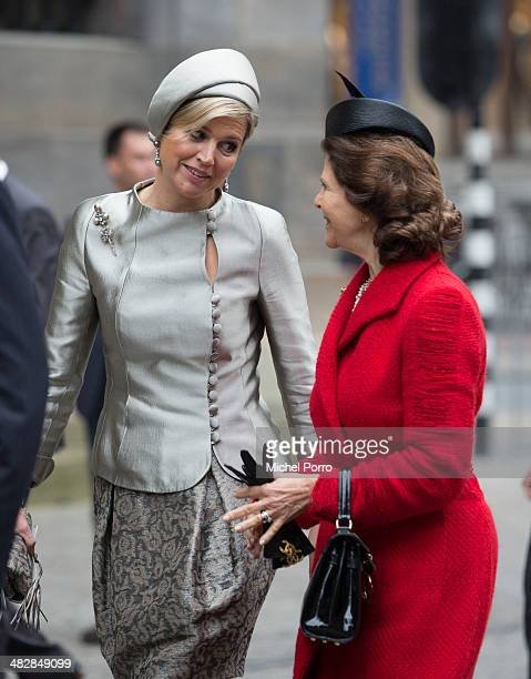 Queen Silvia of Sweden Queen Maxima of The Netherlands walk at the start of an official two day visit to Holland on April 4 2014 in Amsterdam...