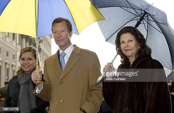 Queen Silvia Of Sweden Shows Grand Duke Henri Of Luxembourg And Grand Duchess Maria Theresa Of Luxembourg The Old Town In Stockholm, Sweden During...