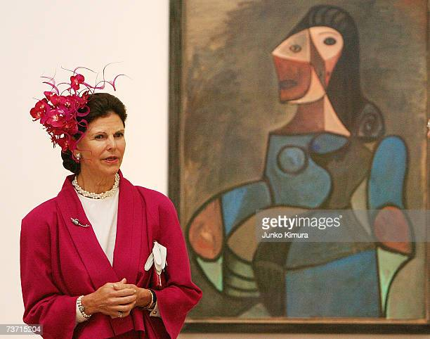 Queen Silvia of Sweden stands in front of a painting by Pablo Picasso during her visit to the National Art Center on March 27 2007 in Tokyo Japan The...