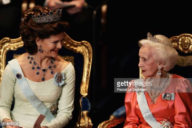Queen Silvia of Sweden talks to Princess Lilian during the awarding ceremony of the Nobel Prizes at City Hall December 10, 2004 in Stockholm, Sweden....