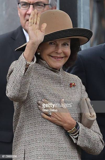 Queen Silvia of Sweden waves to cheering onlookers while visiting the construction site of the Berliner Stadtschloss palace with her husband, King...