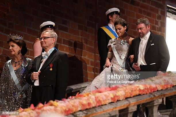 Queen Silvia of SwedenChairman of the board of the Nobel Foundation Professor CarlHenrik Heldin Crown Princess Victoria of Sweden and Professor J...