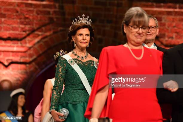Queen Silvia of SwedenNobel Foundation chairman CarlHenrik Heldin and Donna Strickland laureate of the Nobel Prize in Physics attend the Nobel Prize...