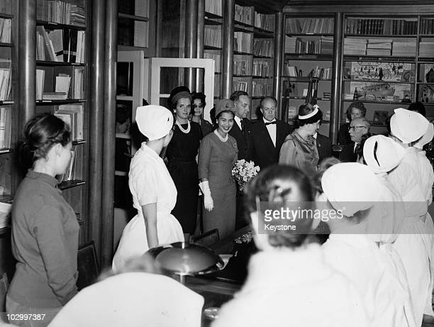 Queen Sirikit of Thailand holding a bouquet of flowers as she arrives at the library of a nursery on Boulevard Brune in Paris France 1960