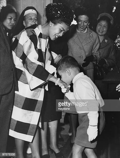 Queen Sirikit of Thailand recieves a special welcome from a little boy at the Cesare Battisti Children's Institute run by the Italian Red Cross in...