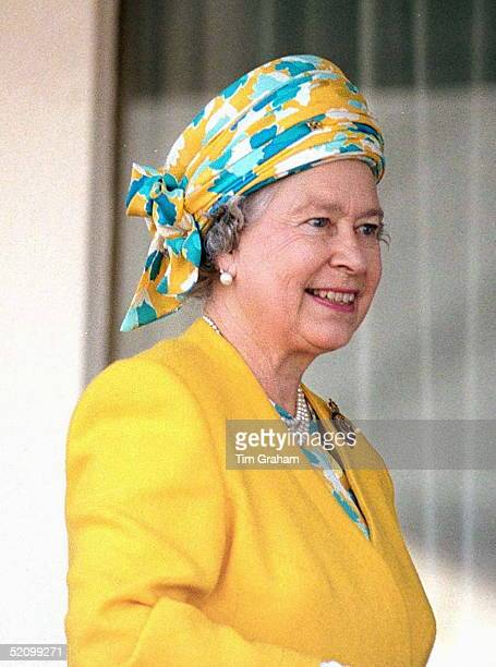 Queen Smiling As She Boards Royal Yacht Britannia For Her Traditional Holiday Cruise Of The Western Isles Wearing A Turban Style Hat
