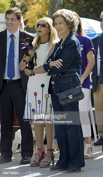Queen Sofia and Alejandra Botto attend Perroton Village at Retiro Park on October 5 2014 in Madrid Spain