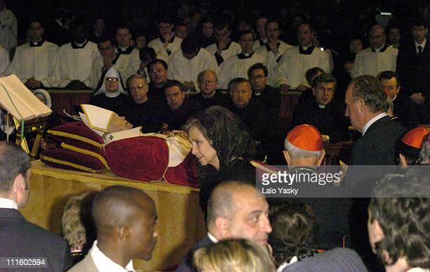 Queen Sofia and King Juan Carlos of Spain pay their respects to Pope John Paul II as he lies in state at St Peter's Basilica in the Vatican on Friday...
