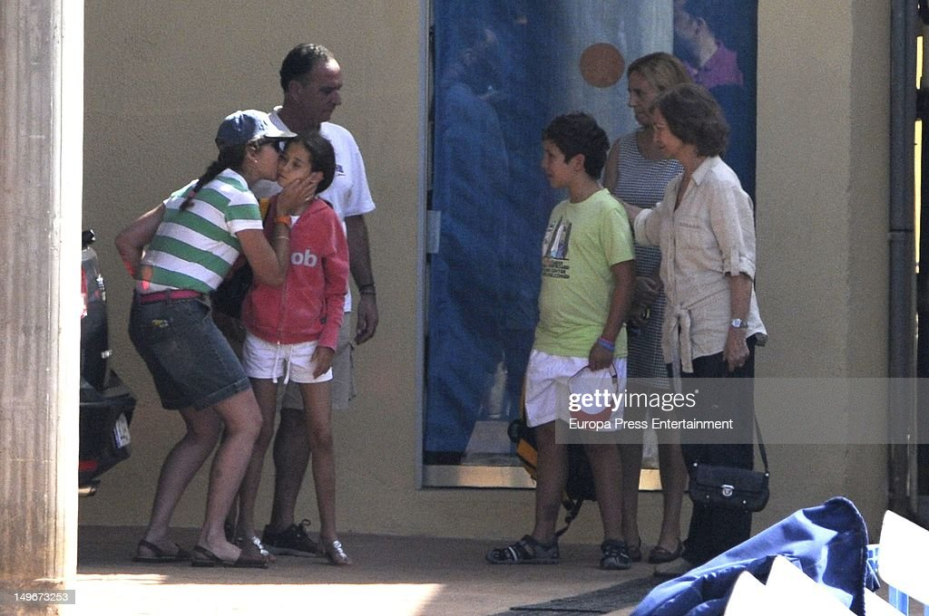 Queen Sofia of Spain (R) and Princess Elena of Spain (L) and her sons Felipe and Victoria Federica are seen in the navy club on August 1, 2012 in Palma de Mallorca, Spain. The children are attending sailing classes.