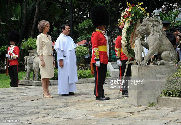 Queen Sofia of Spain and University of Santo Tomas rector father Herminio Dagohoy pay respects after Sofia laid a wreath on the monument of Roman...