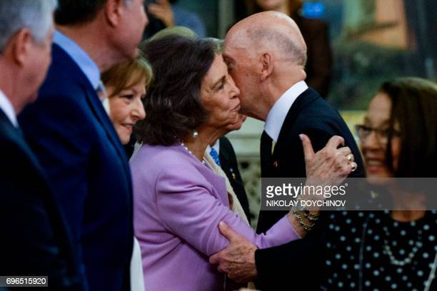 Queen Sofia of Spain congratulates Bulgaria's exKing and former Prime Minister Simeon SaxeCoburgGotha after a mass to celebrate his 80th birthday at...
