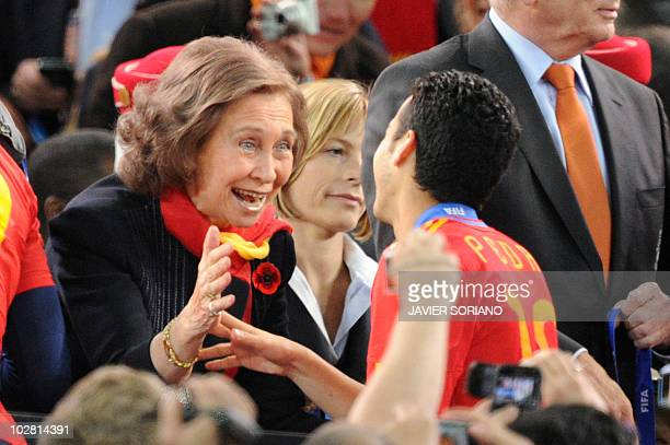 Queen Sofia of Spain greets Spain's striker Pedro during the medals ceremony at the end of the 2010 World Cup football final between the Netherlands...