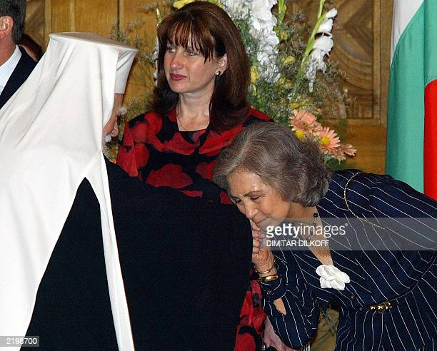 Queen Sofia of Spain kisses a hand of Bulgarian Partiarch Maxim during an official reception at Bulgaria's National Museum of History in Sofia 10...