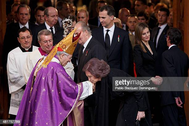 Queen Sofia of Spain kisses the hand of Archbishop of Madrid Rouco Varela after the state funeral ceremony for former Spanish prime minister Adolfo...