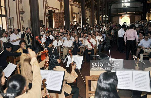 Queen Sofia of Spain listens to a concert of students of the Municipal School and Orchestra of San Jose de Patriarca in San Jose de Chiquitos Santa...