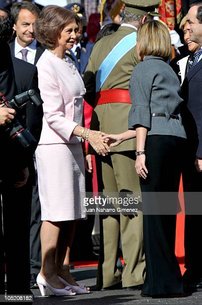 Queen Sofia of Spain shakes hands with Carme Chacon during National Day Military Parade in the Paseo de la Castellana on October 12 2010 in Madrid...