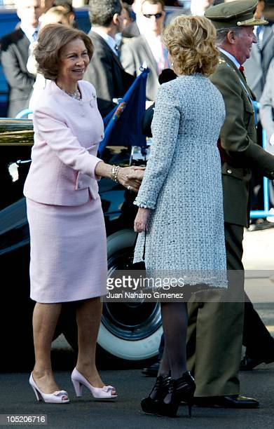 Queen Sofia of Spain shakes hands with Esperanza Aguirre at National Day Military Parade in the Paseo de la Castellana on October 12 2010 in Madrid...