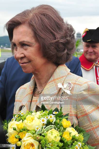 Queen Sofia of Spain smiles as she arrives with King Juan Carlos of Spain and is welcomed by Swiss President Micheline CalmyRey at Zurich airport on...
