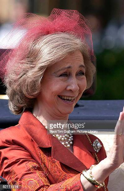 Queen Sofia Of Spain Smiling And Waving Whilst Riding In A Open Carriage At The Annual Order Of The Garter Ceremony