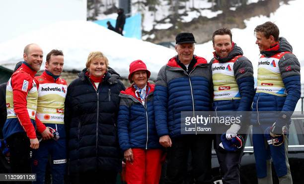 Queen Sonja of Norway and Harald V of Norway celebrate with the Norwegian team winning the gold medal in the Men's Cross Country Relay during the...