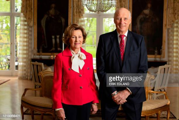 Queen Sonja of Norway and King Harald of Norway pose in the garden room of the royal estate in Oslo Norway on May 16 on the eve of the Norwegian...