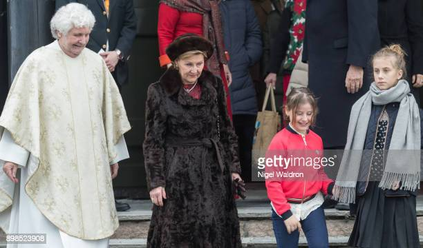 Queen Sonja of Norway Emma Tallulah Behn of Norway and Leah Isadora Behn of Norway leave the Christmas service at the Holmenkollen Chapel on December...