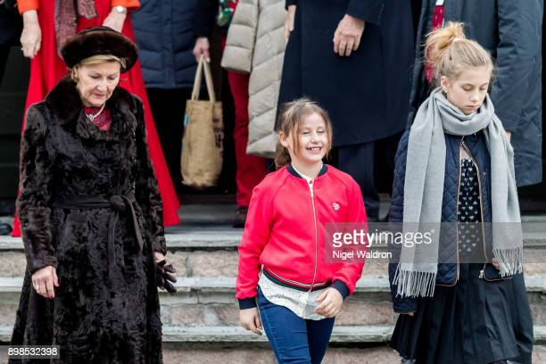 Queen Sonja of Norway Emma Tallulah Behn of Norway and Leah Isadora Behn of Norway leave the Christmas service at Holmenkollen Chapel on December 25...