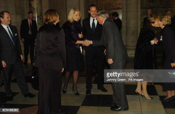 Queen Sonja of Norway greets the Duchess of Gloucester as the Duke of Gloucester is introduced to Crown Princess Mette-Marit and Crown Prince Haakon .