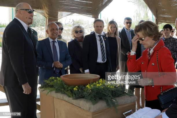 Queen Sonja of Norway makes the sign of the cross as she and King Harald V visit the baptism site of alMaghtas where Jesus is believed by Christians...