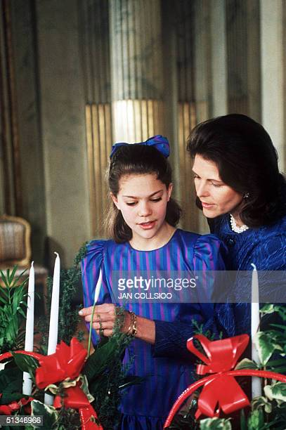 Queen Sophia of Sweden and her daughter Crown Princess Victoria arrange bouquet during traditional Christmas photo session 18 December 1992 at the...