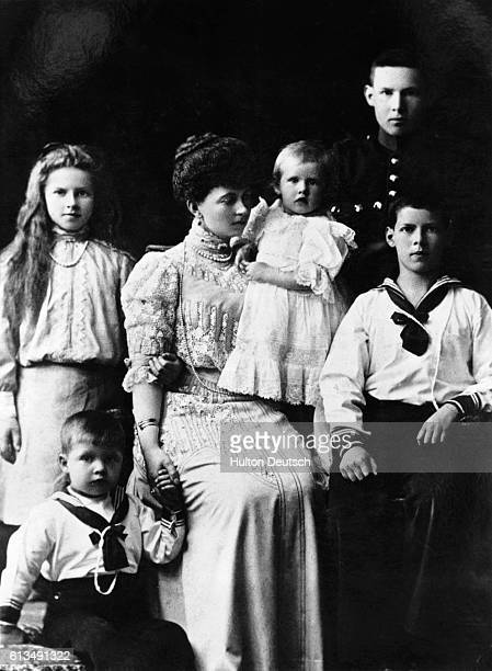Queen Sophia, the wife of Constantine I, with her daughters, the Princesses Helen and Irene , and her sons Prince Paul , Prince George, and Prince...