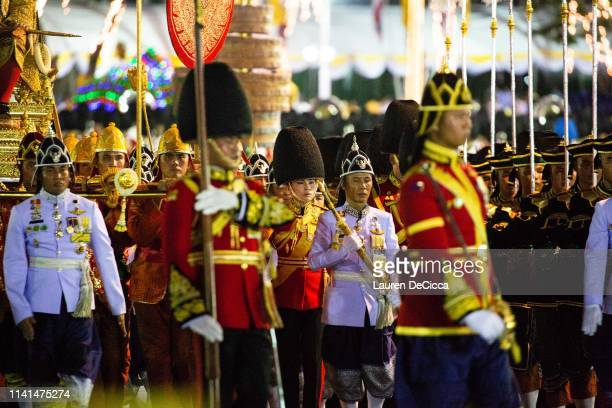 Queen Suthida Vajiralongkorn Na Ayudhya marches with her husband King Maha Vajiralongkorn during the Royal Land Procession following his coronation...