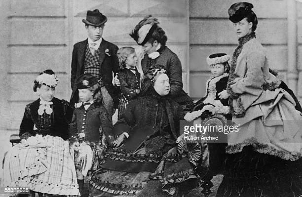 Queen Victoria and her family at Osborne House on the Isle of Wight, 1870. On the right is her daughter-in-law, later Queen Alexandra and behind is...