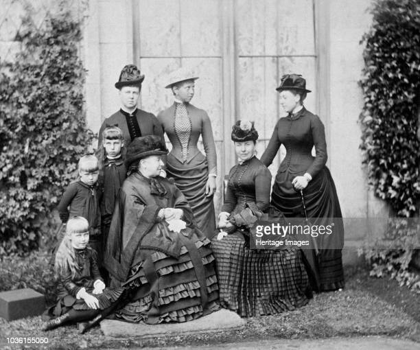 Queen Victoria and her family, Balmoral, Scotland, 1884. Photograph from a Royal Family album at Osborne House, Isle of Wight. Seated - on the...