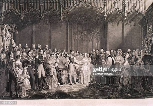 Queen Victoria and Prince Albert's marriage in St James's Palace London 1840 the couple are shown holding hands before the cleric performing the...
