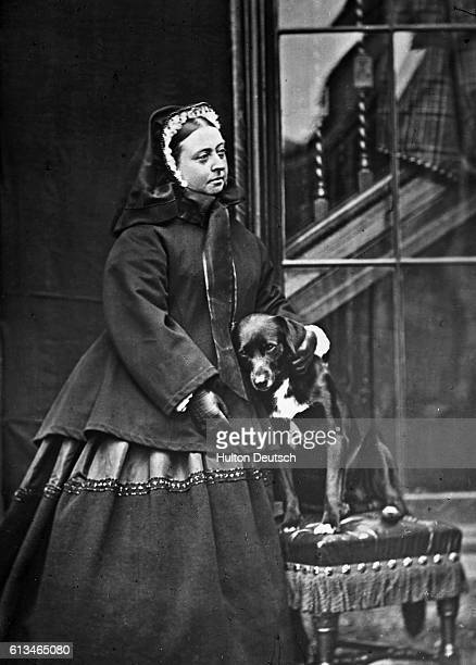 Queen Victoria At Balmoral 1867 Queen Victoria with dog [Sharp] with one of the very few photos in which the Queen is seen to smile