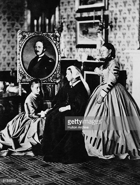 Queen Victoria at Balmoral with her daughters Princess Alice and Princess Louise Duchess of Argyll and a portrait of her late husband Prince Albert