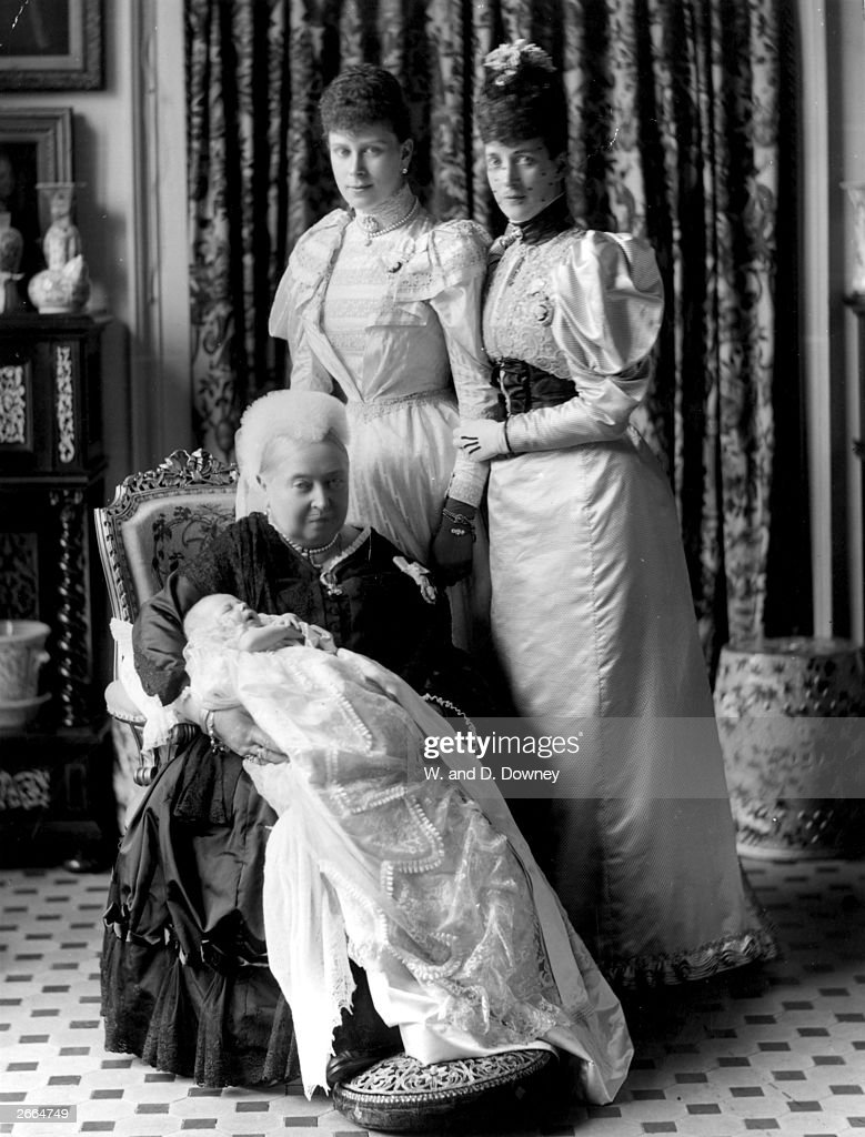 Queen Victoria (1819 - 1901) at the christening of her great-grandson, the future King Edward VIII (1894 - 1972), with the baby's mother Mary of Teck and grandmother Alexandra.