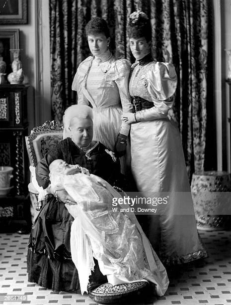 Queen Victoria at the christening of her greatgrandson the future King Edward VIII with the baby's mother Mary of Teck and grandmother Alexandra at...