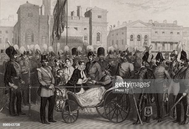 Queen Victoria distributing Crimean Medals at Horse Guards London 18 May 1856 She is presenting a medal to Sir Thomas Troubridge who lost his right...