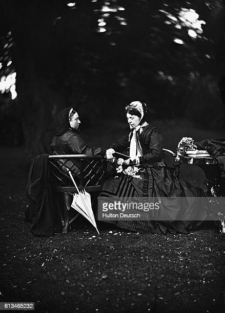 Queen Victoria of England with Empress of Augusta of Germany in the gardens of Frogmore House Augusta is the mother of Crown Prince Frederick William...