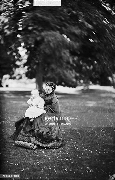 Queen Victoria of Great Britain holding her great grandson, Crown Prince Wilhelm of Germany , 1883. The crown prince is the son of future German...