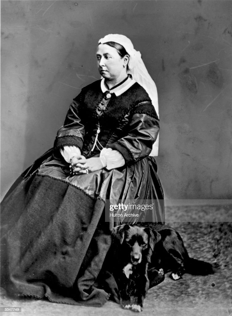 Queen Victoria (1819 - 1901), of Great Britain with her dog Sharp.